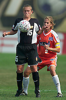 Tiffeny Milbrett of the Power looks to control the ball while being marked by Kelly Lindsey. The San Jose CyberRays were defeated by the NY Power played 2-1 on 7/05/03 at Mitchel Athletic Complex, Uniondale, NY..