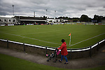 Elgin City 3 Edinburgh City 0, 13/08/2016. Borough Briggs, Scottish League Two. A woman pushing a child in a buggy around the terracing during the first-half at Borough Briggs, home to Elgin City, on the day they played SPFL2 newcomers Edinburgh City (in yellow). Elgin City were a former Highland League club who were elected to the Scottish League in 2000, whereas Edinburgh City became the first club to gain promotion to the League by winning the Lowland League title and subsequent play-off matches in 2015-16. This match, Edinburgh City's first away Scottish League match since 1949, ended in a 3-0 defeat, watched by a crowd of 610. Photo by Colin McPherson.