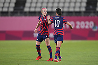 KASHIMA, JAPAN - AUGUST 5: Carli Lloyd #10 of the United States shakes hands with Becky Sauerbrunn #4 during a game between Australia and USWNT at Kashima Soccer Stadium on August 5, 2021 in Kashima, Japan.