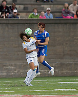 Boston Breakers defender Amy LePeilbet (6) and Los Angeles Sol forward Han Duan (9) battle for head ball. The Boston Breakers defeated Los Angeles Sol, 2-1, at Harvard Stadium on May 2, 2009.