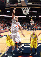 CHARLOTTESVILLE, VA- NOVEMBER 29: Malcolm Brogdon #22 of the Virginia Cavaliers shoots the ball in front of Michigan Wolverine defenders during the game on November 29, 2011 at the John Paul Jones Arena in Charlottesville, Virginia. Virginia defeated Michigan 70-58. (Photo by Andrew Shurtleff/Getty Images) *** Local Caption *** Malcolm Brogdon
