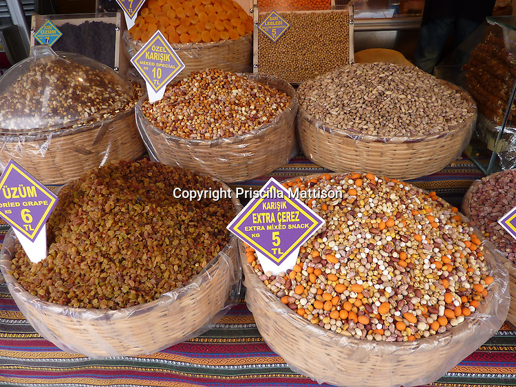 Istanbul, Turkey - September 21, 2009:  Baskets of dried fruit and nuts are for sale at a bazaar.