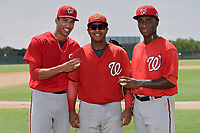 GCL Nationals starting pitcher Joan Baez (left) and relief pitcher Jose Jimenez (right) pose for a photo with catcher Jose Cabello (center) after combining to throw a seven inning no-hitter in the first game of a doubleheader against the GCL Marlins. Baez went six hitless innings, walking one, and striking out seven; Jimenez closed it out with a hitless inning allowing a walk. The GCL Nationals defeated the GCL Marlins 4-0. (Mike Janes/Four Seam Images)