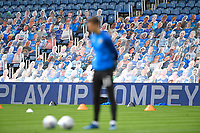 An Oxford United player warms up in front of the Pompey faithful during Portsmouth vs Oxford United, Sky Bet EFL League 1 Play-Off Semi-Final Football at Fratton Park on 3rd July 2020