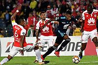 BOGOTA - COLOMBIA - 01 - 03 - 2018: William Tesillo (Izq.), William Tesillo (2 Izq.) y Javier Lopez (Der.) jugadores de Independiente Santa Fe disputan el balón con Eduar Preciado (Cent.), jugador de Emelec (ECU), durante partido entre Independiente Santa Fe (COL) y Emelec (ECU), de la fase de grupos, grupo 4, fecha 1 de la Copa Conmebol Libertadores 2018, jugado en el estadio Nemesio Camacho El Campin de la ciudad de Bogota. / William Tesillo (L) and William Tesillo (2 L) and Javier Lopez (R) players of Independiente Santa Fe vie for the ball with Eduar Preciado (C), player of Emelec (ECU), during a match between Independiente Santa Fe (COL) and Emelec (ECU), of the group stage, group 4, 1st date for the Conmebol Copa Libertadores 2018 at the Nemesio Camacho El Campin Stadium in Bogota city. Photo: VizzorImage  / Luis Ramirez / Staff.