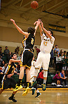 Manogue's Remy Dillard shoots over Galena defender Josiah Wood at Manogue High School in Reno, Nev., on Tuesday, Feb. 11, 2014. Manogue won 66-59.<br /> Photo by Cathleen Allison