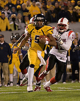 WVU quarterback Pat White (5) takes off on a game-winning 50-yard touchdown run late in the fourth quarter.  The West Virginia Mountaineers defeated the Louisville Cardinals 38-31 on November 08, 2007 at Mountaineer Field, Morgantown, West Virginia. .