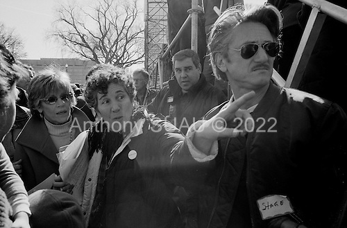 """Washington DC.District of Columbia.USA.January 27, 2007..US Actor Sean Penn watches behind the stage as he attends an anti-war demonstration on the National Mall in Washington DC. Just behind him (left) is US actress Jane Fonda. Tens of thousands massed to demand that Congress cut off funds for the Iraq war. He later addressed the crowd...Actor Sean Penn said lawmakers will pay a price in the 2008 elections if they do not take firmer action than to pass a nonbinding resolution against the war, the course Congress is now taking. """"If they don't stand up and make a resolution as binding as the death toll, we're not going to be behind those politicians,"""" he said. ...."""