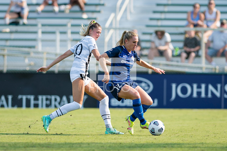 CARY, NC - SEPTEMBER 12: Kelli Hubly #20 of the Portland Thorns defends against Amy Rodriguez #12 of the NC Courage during a game between Portland Thorns FC and North Carolina Courage at WakeMed Soccer Park on September 12, 2021 in Cary, North Carolina.