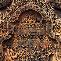 Ancient 10th century Banteay Srei temple of Shiva with beautiful engraved wall details in Angkor Wat Siem Reap complex, Cambodia Southeast Asia