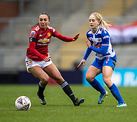 7th February 2021; Leigh Sports Village, Lancashire, England; Women's English Super League, Manchester United Women versus Reading Women; Katie Zelem of Manchester United Women and Amalie Eikeland of Reading looks for the ball