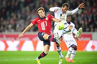 Nolan Roux (LOSC) vs Jonathan Zebina (TFC) .Football Calcio 2012/2013.Ligue 1 Francia.Foto Panoramic / Insidefoto .ITALY ONLY