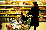Mother and child supermarket weekly shopping London England 1990s UK