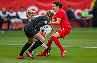 CARSON, CA - FEBRUARY 9: GK Alyssa Naeher #1 of USA saves a ball with help from teammate Abby Dahlkemper #7 as she defends against an advancing Christine Sinclair #12 of Canada during a game between Canada and USWNT at Dignity Health Sports Park on February 9, 2020 in Carson, California.