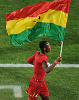 John Pantsil of Ghana takes a lap of honour with the Ghana national flag. Ghana defeated the USA 2-1 in overtime in the 2010 FIFA World Cup at Royal Bafokeng Stadium in Rustenburg, South Africa on June 26, 2010.