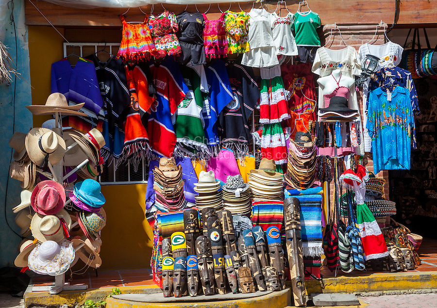 Souvenir Shops Selling Hats, Masks, Clothing, Paraphernalia.  Playa del Carmen, Riviera Maya, Yucatan, Mexico.