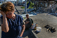 Citizens of Slovyansk near a building recentlly destroyed during an assault of Ukrainian Army on Slovyansk