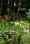 Bird bath in flower garden on Cape Cod.