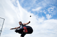 Josh Goldthorp competes in the stone throw during the 2015 Alaska Scottish Highland Games at the Palmer fairgrounds.
