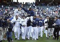 04 October 2009: Ichiro Suzuki (left) high fives Ken Griffey Jr as they get carried off the field by teammates. Seattle won 4-3 over the Texas Rangers at Safeco Field in Seattle, Washington.