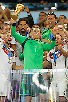 Goalkeeper Manuel Neuer of Germany celebrates winning the FIFA World Cup trophy with team mates
