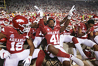 Arkansas players celebrate a win, Saturday, November 7, 2020 following a football game at Donald W. Reynolds Razorback Stadium in Fayetteville. Check out nwaonline.com/201108Daily/ for today's photo gallery. <br /> (NWA Democrat-Gazette/Charlie Kaijo)