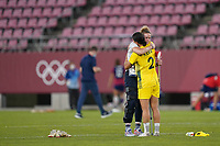 KASHIMA, JAPAN - AUGUST 5: Alyssa Naeher #1 of the United States hugs Sam Kerr #2 of Australia after a game between Australia and USWNT at Kashima Soccer Stadium on August 5, 2021 in Kashima, Japan.