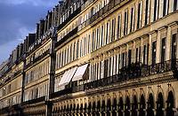 Buildings on Rue de Rivoli at sunset, Paris, France.