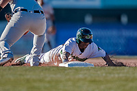 19 June 2018: Vermont Lake Monsters infielder Marcos Brito dives safely back to first in the 2nd inning against the Connecticut Tigers at Centennial Field in Burlington, Vermont. The Lake Monsters defeated the Tigers 5-4 in the conclusion of a rain-postponed Lake Monsters Opening Day game started June 18. Mandatory Credit: Ed Wolfstein Photo *** RAW (NEF) Image File Available ***
