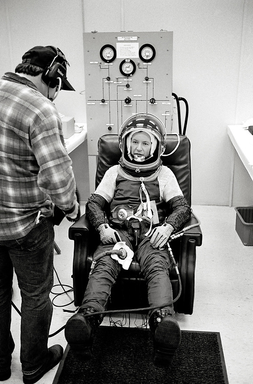 Image copyright John Angerson. <br /> STS-72 mission training.<br /> Commander Brian Duffy during his spacesuit fitting before flight simulation. Duffy was a veteran of four space flights and logged a total of 40 days, 17 hours, 34 minutes, and 59 seconds in space.Kennedy Space Center, Florida, USA.