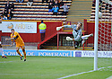 MOTHERWELL'S TIM CLANCY WATCHES AS HIS HEADER COMES OFF THE INSIDE OF THE POST