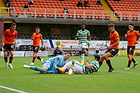 22nd August 2020; Tannadice Park, Dundee, Scotland; Scottish Premiership Football, Dundee United versus Celtic; Benjamin Siegrist of Dundee United dives in to save from Mohamed Elyounoussi of Celtic