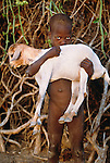 Bumi child and goat, Murle Region, Ethiopia