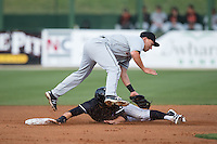 Delmarva Shorebirds second baseman Drew Turbin (9) reaches for a low throw as Tyler Sullivan (5) of the Kannapolis Intimidators steals second base at Kannapolis Intimidators Stadium on April 11, 2016 in Kannapolis, North Carolina.  (Brian Westerholt/Four Seam Images)