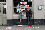 London 4th July 2020. Super Saturday, bars and pubs open with restrictions in place, social distancing, table service, limited numbers of drinkers in the bar. Portobello Road young Londoners. Teen girls having a pint. The circles on the pavement are 6 feet apart.