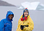 Two young women pose in front of an iceberg off the coast of Greenland. The women are studetns with the Cape Farewell Youth Expedition, organized by the British Council of Canada.