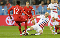 TORONTO, ON - OCTOBER 15: Michael Bradley #4 of the United States attempts a slide tackle on Alphonso Davies #12 of Canada during a game between Canada and USMNT at BMO Field on October 15, 2019 in Toronto, Canada.