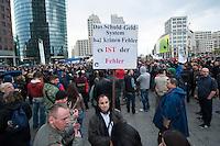 """Verschiedene Verschwoerungstheoretiker und rechte Gruppen versammelten sich am Montag den 21. April 2014 auf dem Potsdamer Platz zu einer sog. Montagsdemonstration unter dem Label """"Friedensbewegung 2.0"""". Zu der """"Manhwache"""" kamen weit ueber 1.00 Menschen.<br /> Die Macher der Montagsdemo-Mahnwachen sehen sich selber als eine """"Buergerbewegung fuer den Frieden, mit demokratischer demokratischer Gesinnung"""". In Redebeitraegen wird gegen das internationale Finanzkapital, namentlich festgemacht an dem Boersenspekulanten Georg Soros oder der Familie Rothschild, gewettert. Laut dem Organisator ist die US-Notenbank FED fuer die Kriege der letzten 100 Jahre verantwortlich.<br /> Unter den Teilnehmern der Demonstration befanden sich der Berliner NPD-Vorsitzende Sebastian Schmidtke mit Anhang und auch die rechten """"Reichsbuerger"""" die Deutschland als Staat ablehnen und das Deutsche Reich zurueck wollen.<br /> Kritiker der Veranstaltung bezeichnen die Veranstaltung als sog. """"Querfrontstrategie"""" bei der Rechte versuchen linke Themen zu besetzen ohne dass die Menschen bemerken, dass die Veranstalter Rechte sind.<br /> 21.4.2014, Berlin<br /> Copyright: Christian-Ditsch.de<br /> [Inhaltsveraendernde Manipulation des Fotos nur nach ausdruecklicher Genehmigung des Fotografen. Vereinbarungen ueber Abtretung von Persoenlichkeitsrechten/Model Release der abgebildeten Person/Personen liegen nicht vor. NO MODEL RELEASE! Don't publish without copyright Christian-Ditsch.de, Veroeffentlichung nur mit Fotografennennung, sowie gegen Honorar, MwSt. und Beleg. Konto:, I N G - D i B a, IBAN DE58500105175400192269, BIC INGDDEFFXXX, Kontakt: post@christian-ditsch.de<br /> Urhebervermerk wird gemaess Paragraph 13 UHG verlangt.]"""