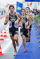 28 APR 2012 - LES SABLES D'OLONNE, FRA - David Hauss (left) leads his Les Sables Vendee Triathlon team mates Joao Silva (centre) and Pierre Le Corre (right) onto the second lap of the run of the prologue round of the French Grand Prix Series triathlon in Les Sables d'Olonne, France (PHOTO (C) 2012 NIGEL FARROW)