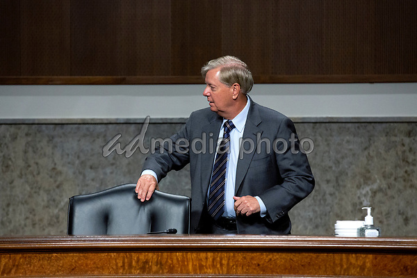 United States Senator Lindsey Graham (Republican of South Carolina) arrives to the U.S. Senate Committee on the Judiciary hearing on Capitol Hill in Washington D.C., U.S.,  as they consider the nomination of Cory Wilson to be United States Circuit Judge For The Fifth Circuit on Wednesday, May 20, 2020.  Credit: Stefani Reynolds / CNP/AdMedia