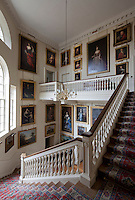 The paintings on the grand staircase include full-length portraits by Sir Peter Lely of Frances Stuart, Duchess of Richmond (top left) and Barbara Villiers, Duchess of Cleveland (directly below chandelier)