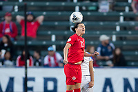 CARSON, CA - FEBRUARY 07: Christine Sinclair #12 of Canada heads a ball during a game between Canada and Costa Rica at Dignity Health Sports Complex on February 07, 2020 in Carson, California.