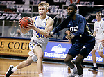 SIOUX FALLS, SD - MARCH 8: Charlie Easley #30 of the South Dakota State Jackrabbits looks to kick the ball as DeShang Weaver #14 of the Oral Roberts Golden Eagles defends during the Summit League Basketball Tournament at the Sanford Pentagon in Sioux Falls, SD. (Photo by Richard Carlson/Inertia)