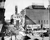 1964 FILE PHOTO -<br /> <br /> Then and now. The corner of Queen and Victoria Sts. hasn't changed much since photographer Boris Spremo took the above shot back in 1964. The building that housed the old Town Tavern still stands; but these days; the Old City Hall is obscured by The Eaton Centre.
