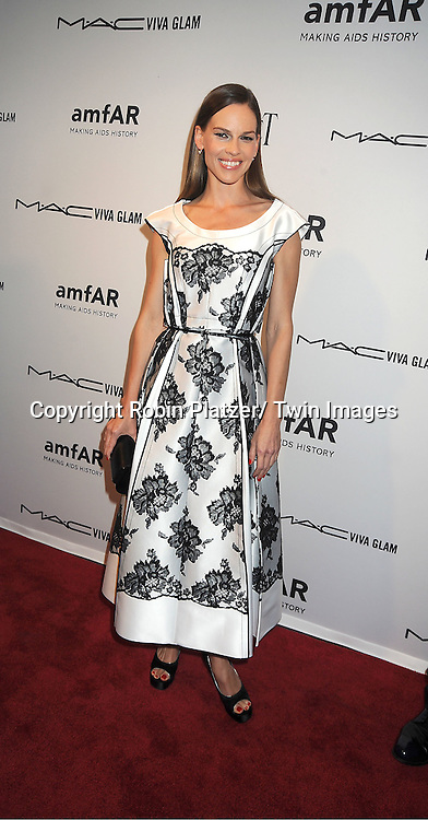 Hilary Swank in Marc Jacobs black dress attends the amfAR Inspiration Gala on June 7, 2012 at The New YOrk Public Library in New York City. The honorees were Fergie and Robert Duffy/ Marc Jacobhs International and the Scissor Sisters performed.