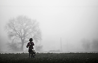 Pictured: Children play in a field Tuesday 08 March 2016<br /> Re: Heavy overnight rain has flooded the migrant camp at the Greek FYRO Macedonian border of Idomeni in Greece