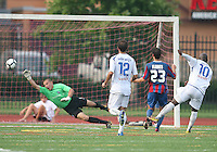 Evan Bush #1 of Crystal Palace Baltimore is beaten on a shot by Ali Gerba #10 of the Montreal Impact for a goal during an NASL match at Paul Angelo Russo Stadium in Towson, Maryland on August 21 2010. Montreal won 5-0.