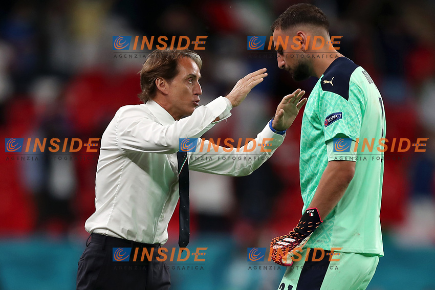 LONDON, ENGLAND - JUNE 26: Gianluigi Donnarumma of Italy celebrates their side's first goal scored by team mate Federico Chiesa (not pictured) with Roberto Mancini, Head Coach of Italy during the UEFA Euro 2020 Championship Round of 16 match between Italy and Austria at Wembley Stadium at Wembley Stadium on June 26, 2021 in London, England. (Photo by Alex Morton - UEFA/UEFA via Getty Images)<br /> Photo Uefa/Insidefoto ITA ONLY