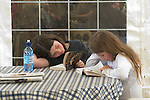 Young readers at the festival site. The Hay Festival, Hay on Wye, Powys, Wales, Great Britain. 2006.