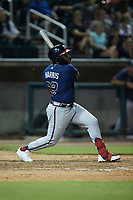 Trey Harris (22) of the Mississippi Braves follows through on his swing against the Birmingham Barons at Regions Field on August 3, 2021, in Birmingham, Alabama. (Brian Westerholt/Four Seam Images)